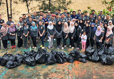 AMBD, Green Brunei join forces to clean up Berakas Beach